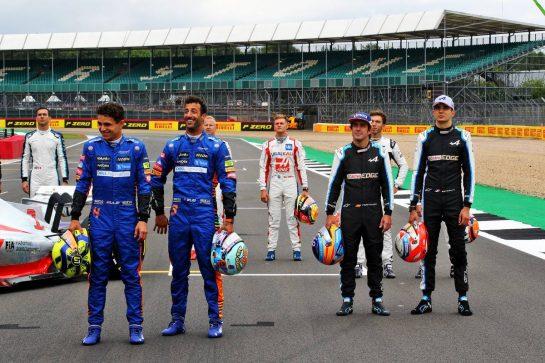 (L to R): Lando Norris (GBR) McLaren and Daniel Ricciardo (AUS) McLaren; Fernando Alonso (ESP) Alpine F1 Team and Esteban Ocon (FRA) Alpine F1 Team - 2022 Car Launch. 15.07.2021. Formula 1 World Championship, Rd 10, British Grand Prix, Silverstone, England, Preparation Day.  - www.xpbimages.com, EMail: requests@xpbimages.com © Copyright: Davenport / XPB Images