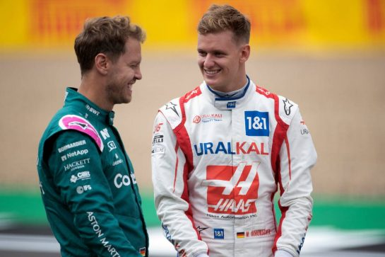 (L to R): Sebastian Vettel (GER) Aston Martin F1 Team and Mick Schumacher (GER) Haas F1 Team - 2022 Car Launch. 15.07.2021. Formula 1 World Championship, Rd 10, British Grand Prix, Silverstone, England, Preparation Day. - www.xpbimages.com, EMail: requests@xpbimages.com © Copyright: Staley / XPB Images