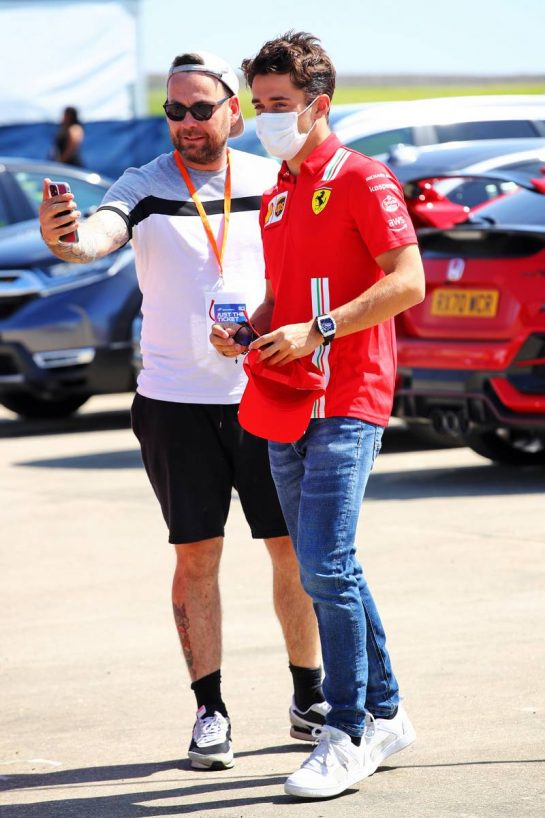 Charles Leclerc (MON) Ferrari with fan. 16.07.2021. Formula 1 World Championship, Rd 10, British Grand Prix, Silverstone, England, Practice Day.  - www.xpbimages.com, EMail: requests@xpbimages.com © Copyright: Davenport / XPB Images