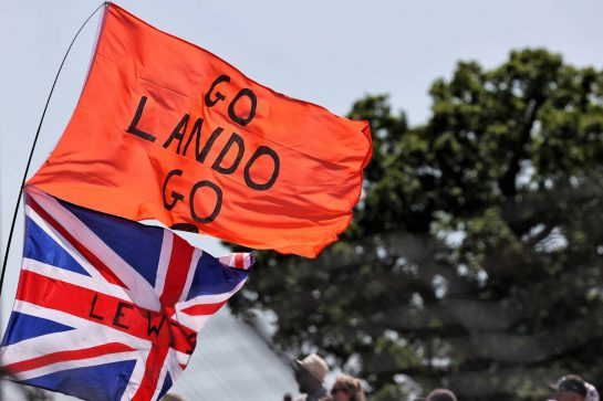 Circuit atmosphere - flags for Lewis Hamilton (GBR) Mercedes AMG F1 and Lando Norris (GBR) McLaren. 17.07.2021. Formula 1 World Championship, Rd 10, British Grand Prix, Silverstone, England, Qualifying Day. - www.xpbimages.com, EMail: requests@xpbimages.com © Copyright: Batchelor / XPB Images