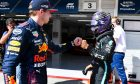 Max Verstappen (NLD) Red Bull Racing congratulates pole sitter Lewis Hamilton (GBR) Mercedes AMG F1 in qualifying parc ferme. 31.07.2021. Formula 1 World Championship, Rd 11, Hungarian Grand Prix, Budapest