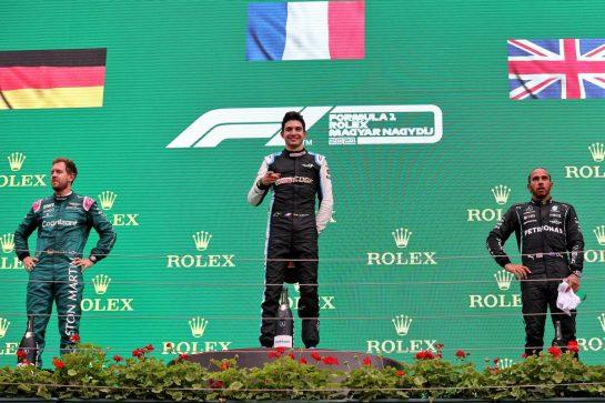 The podium (L to R): Sebastian Vettel (GER) Aston Martin F1 Team, second; Esteban Ocon (FRA) Alpine F1 Team, race winner; Lewis Hamilton (GBR) Mercedes AMG F1, third. 01.08.2021. Formula 1 World Championship, Rd 11, Hungarian Grand Prix, Budapest, Hungary, Race Day. - www.xpbimages.com, EMail: requests@xpbimages.com © Copyright: Charniaux / XPB Images