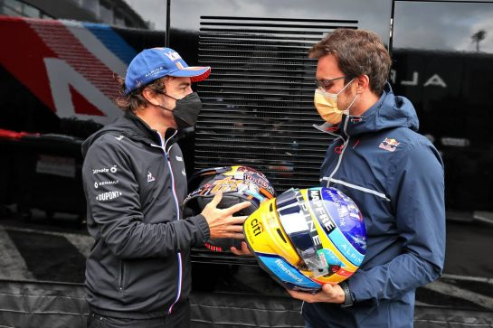 (L to R): Fernando Alonso (ESP) Alpine F1 Team swaps helmets with Thierry Neuville (BEL) WRC Rally Driver. 27.08.2021. Formula 1 World Championship, Rd 12, Belgian Grand Prix, Spa Francorchamps, Belgium, Practice Day. - www.xpbimages.com, EMail: requests@xpbimages.com © Copyright: Moy / XPB Images