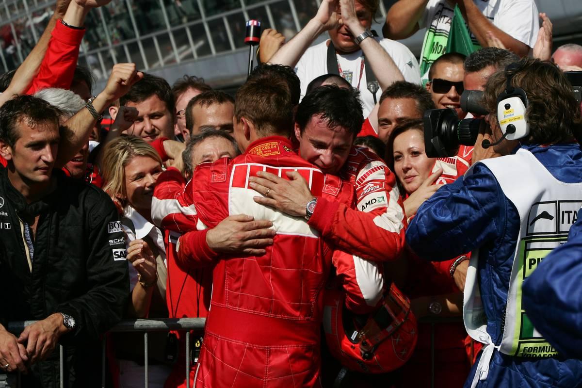 Michael Schumacher (GER), Scuderia Ferrari, in the background. Corina Schumacher (GER), Corinna, Wife of Michael Schumacher and Jean Todt (FRA), Scuderia Ferrari, Teamchief, General Manager, Team Principal - Formula 1 World Championship, Rd 15, Italian Grand Prix