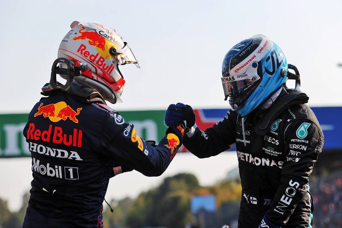 Max Verstappen (NLD) Red Bull Racing, who finished second, celebrates his pole position with first placed finisher Valtteri Bottas (FIN) Mercedes AMG F1, in Sprint parc ferme. 11.09.2021. Formula 1 World Championship, Rd 14, Italian Grand Prix, Monza