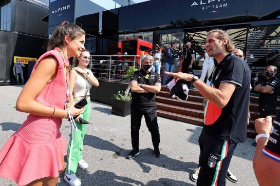 (L to R): Linda Morselli, girlfriend of Fernando Alonso (ESP) Alpine F1 Team, Elena Berri (ITA), girlfriend of Esteban Ocon (FRA) Alpine F1 Team, and Davide Brivio (ITA) Alpine F1 Team Racing Director with Gianmarco Tamberi (ITA) Olympic High Jump Champion. 12.09.2021. Formula 1 World Championship, Rd 14, Italian Grand Prix, Monza, Italy, Race Day. - www.xpbimages.com, EMail: requests@xpbimages.com © Copyright: Moy / XPB Images