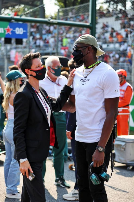 Usain Bolt (JAM) Athlete with Ellie Norman, F1 Director of Marketing and Communications on the grid. 12.09.2021. Formula 1 World Championship, Rd 14, Italian Grand Prix, Monza, Italy, Race Day. - www.xpbimages.com, EMail: requests@xpbimages.com © Copyright: Moy / XPB Images