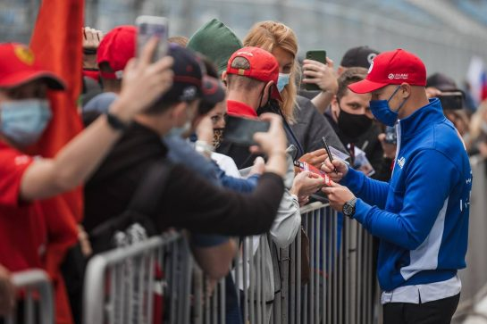 Nikita Mazepin (RUS) Haas F1 Team signs autographs for the fans in the pits. 23.09.2021. Formula 1 World Championship, Rd 15, Russian Grand Prix, Sochi Autodrom, Sochi, Russia, Preparation Day. - www.xpbimages.com, EMail: requests@xpbimages.com © Copyright: Bearne / XPB Images