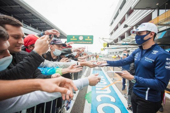 Nicholas Latifi (CDN) Williams Racing signs autographs for the fans in the pits. 23.09.2021. Formula 1 World Championship, Rd 15, Russian Grand Prix, Sochi Autodrom, Sochi, Russia, Preparation Day. - www.xpbimages.com, EMail: requests@xpbimages.com © Copyright: Bearne / XPB Images