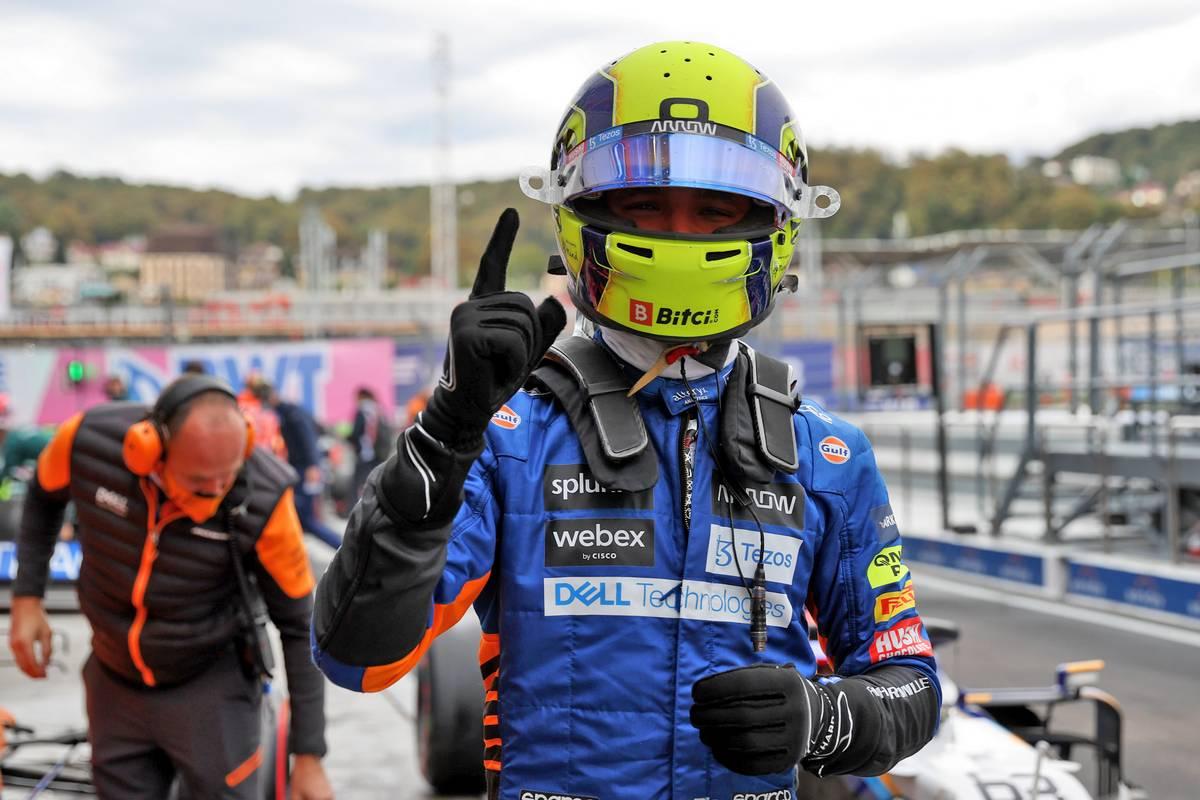 Lando Norris (GBR) McLaren celebrates his pole position in qualifying parc ferme. 25.09.2021. Formula 1 World Championship, Rd 15, Russian Grand Prix, Sochi
