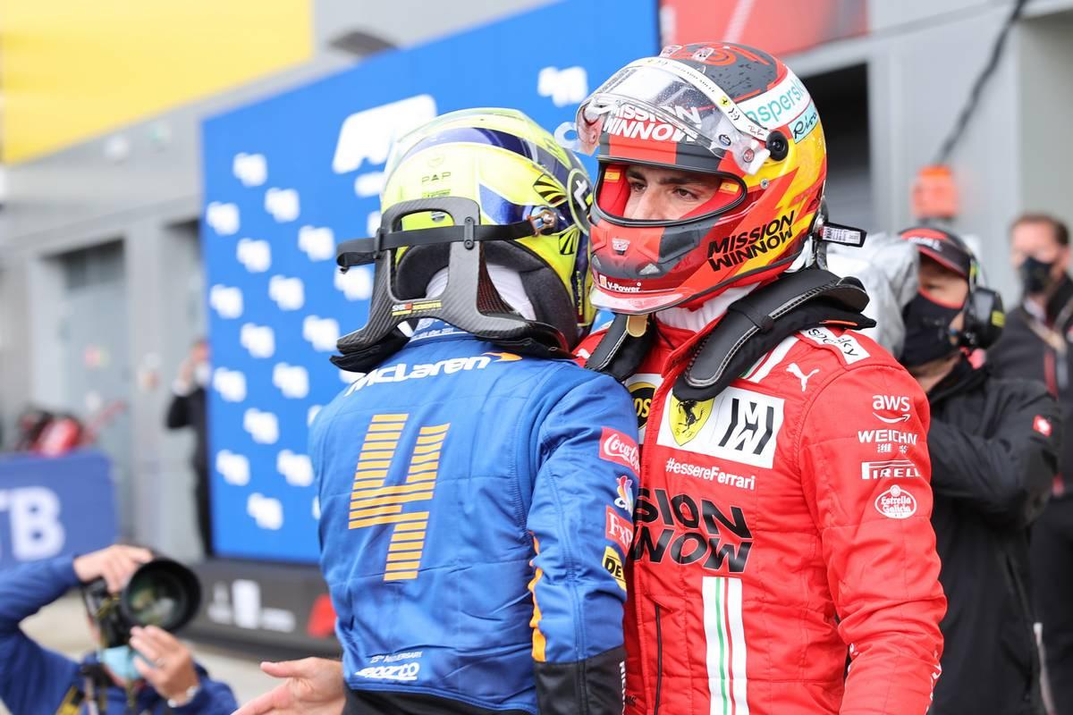 Lando Norris (GBR) McLaren MCL35M and Carlos Sainz Jr (ESP) Ferrari SF-21. 25.09.2021. Formula 1 World Championship, Rd 15, Russian Grand Prix, Sochi