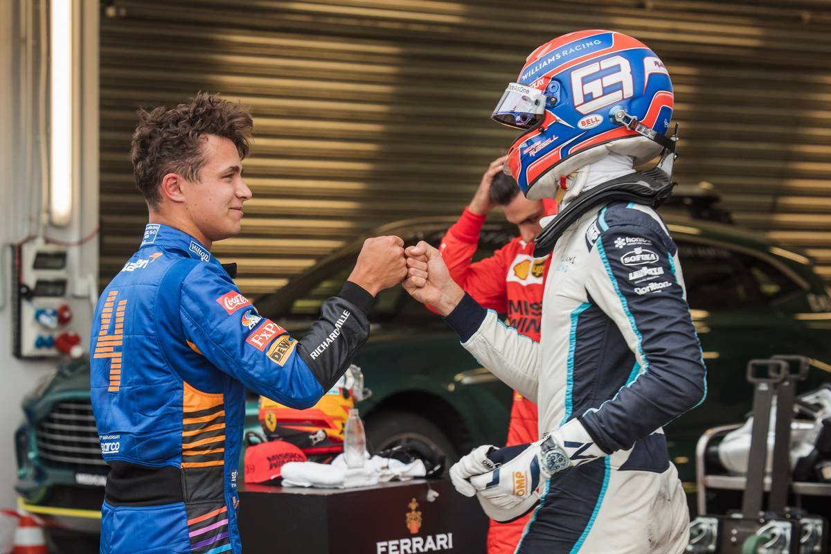 Pole sitter Lando Norris (GBR) McLaren celebrates with third placed George Russell (GBR) Williams Racing in qualifying parc ferme. 25.09.2021. Formula 1 World Championship, Rd 15, Russian Grand Prix, Sochi
