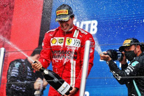 Carlos Sainz Jr (ESP) Ferrari celebrates his third position on the podium. 26.09.2021. Formula 1 World Championship, Rd 15, Russian Grand Prix, Sochi Autodrom, Sochi, Russia, Race Day. - www.xpbimages.com, EMail: requests@xpbimages.com © Copyright: Moy / XPB Images