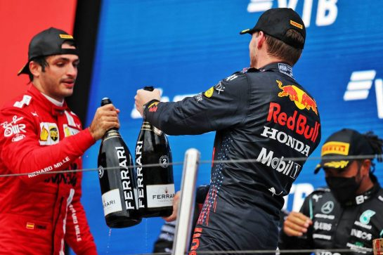 (L to R): Carlos Sainz Jr (ESP) Ferrari celebrates his third position on the podium with second placed Max Verstappen (NLD) Red Bull Racing. 26.09.2021. Formula 1 World Championship, Rd 15, Russian Grand Prix, Sochi Autodrom, Sochi, Russia, Race Day. - www.xpbimages.com, EMail: requests@xpbimages.com © Copyright: Moy / XPB Images