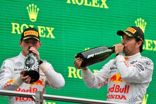 (L to R): Max Verstappen (NLD) Red Bull Racing celebrates his second position on the podium with third placed team mate Sergio Perez (MEX) Red Bull Racing. 10.10.2021. Formula 1 World Championship, Rd 16, Turkish Grand Prix, Istanbul, Turkey, Race Day. - www.xpbimages.com, EMail: requests@xpbimages.com © Copyright: Moy / XPB Images